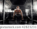 Young shirtless man doing deadlift exercise at gym. 42823231