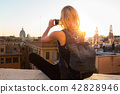 Female tourist taking mobile phone photo of Piazza di Spagna, landmark square with Spanish steps in 42828946