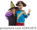 Happy brother and sisters on Halloween 42842835