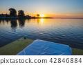 floating cottage on the lake at sunrise 42846884