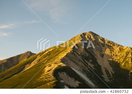 Morning sun illuminated Washira dune 42860732