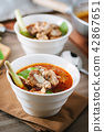 Hot and spicy soup with pork ribs. 42867651