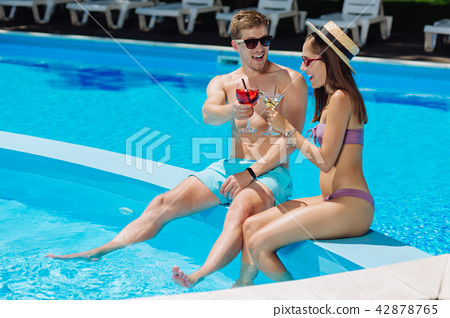 Caring boyfriend celebrating birthday of his girlfriend near pool 42878765