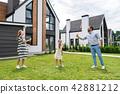 Joyful nice family playing badminton 42881212