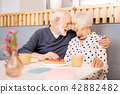 Exuberant senior couple sharing love 42882482