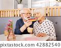 Galant senior man treating wife 42882540