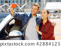 Happy nice man taking a selfie 42884123
