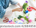 young women business owner florist making or Arranging Artificia 42884858