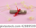 Scroll decorate with white dried flowers 42889509