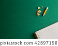 School notebook with pencil on a green background 42897198