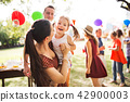Family celebration or a garden party outside in the backyard. 42900003