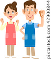 A caregiver wearing an apron · A male and female father 42900844