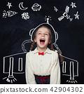 Little girl astronaut having fun. Kids imagination 42904302