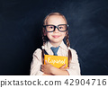 Kid student learning spanish at the classroom 42904716