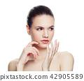 Thinking woman isolated on white background 42905589