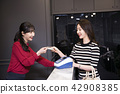 Hairdresser styling woman's hair in a salon. Korean beauty stock photo. 125 42908385
