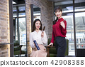 Hairdresser styling woman's hair in a salon. Korean beauty stock photo. 142 42908388