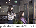 Hairdresser styling woman's hair in a salon. Korean beauty stock photo. 049 42908533