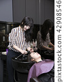 Hairdresser styling woman's hair in a salon. Korean beauty stock photo. 035 42908546