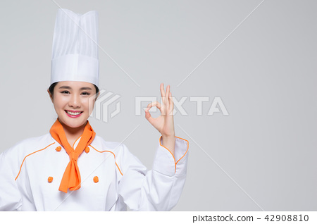 Chef, Cook or baker showing display gesture on empty copy space.Woman chef isolated on white background. 178 42908810