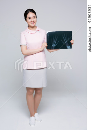 Portrait Of Asian Female Nurse isolated on white background. 060 42908954