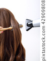 Long colorful hair with objects related to hair salon on close up isolated on background. 122 42909808