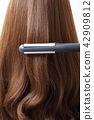 Long colorful hair with objects related to hair salon on close up isolated on background. 116 42909812