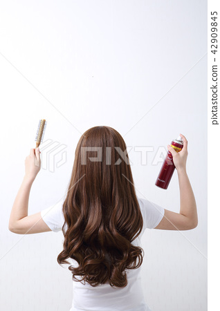 Long colorful hair with objects related to hair salon on close up isolated on background. 119 42909845