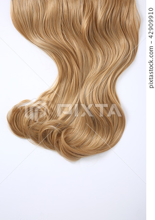 Long colorful hair with objects related to hair salon on close up isolated on background. 060 42909910