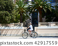 Young woman riding city bicycle near sea 42917559