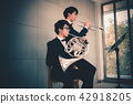 Portrait of couple musician are playing instrument 42918205