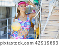 Surfing girl posing with surfboard 42919693