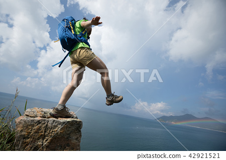 Woman walking off cliff edge with the eyes covered 42921521