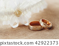 Wedding rings and garter, marriage concept 42922373