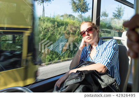 Portrait of tired woman sleeping on bus. 42926495