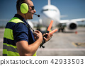 Airport worker using headset for speaking 42933503