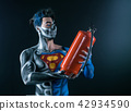 Bodyart of a super hero holding a fire extinguisher in the hands 42934590