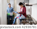 Man And Woman Doing Chores Washing Clothes 42936781