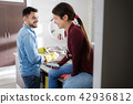 Man And Woman Doing Home Chores In Kitchen 42936812