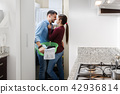 Man And Woman Doing Chores Washing Clothes 42936814