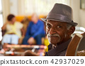 Senior Black Man With Hat Looking At Camera In Hospice 42937029