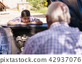 Boy With Grandpa Learning Car Engines From Senior Man 42937076