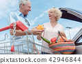 Cheerful senior couple happy for buying fresh vegetables from the hypermarket 42946844