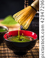 Whisking green Matcha tea in japanese bowl 42947296