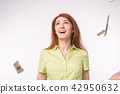 Lottery, financial success concept - Excited woman standing under money rain over white background 42950632
