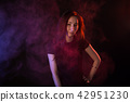 Young woman in neon light and smoke of e-cigarettes or vape on black background 42951230
