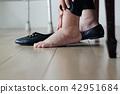 Elderly woman swollen feet putting on shoes 42951684