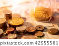 Various of international currency with hourglass 42955581
