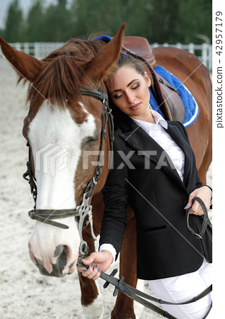 Rider elegant woman riding her horse outside 42957179