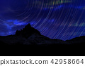 Long exposure image showing Night sky star trails 42958664